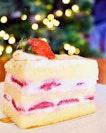 Bearded Bella Fluffy strawberry sponge cake encasing cream and strawberry chunks.