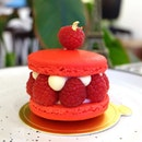 The M Plot Macarons Raspberry Rose Lychee Macaron The macaron shells are rose flavoured sandwiching some huge raspberries with lychee cream.