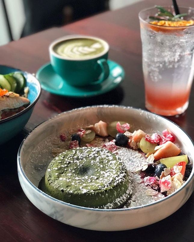 Berry Matcha Lava Cake ($15), housemade warm matcha lava with berry compote, fresh berries and almond flakes on the side.