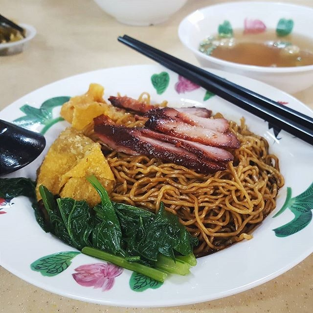 """Nothing says """"SHIOK"""" like a big plate of bouncy egg noodles coated in their special spicy black sauce, with a side of tender char siew."""