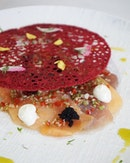 Carpaccio ($18) – stunning red coral tullie revealing a bed of braised daikon radish, fish slices, lime mayo and black fish roe with citrus Asian dressing and herb oil, drizzled with lime zest.