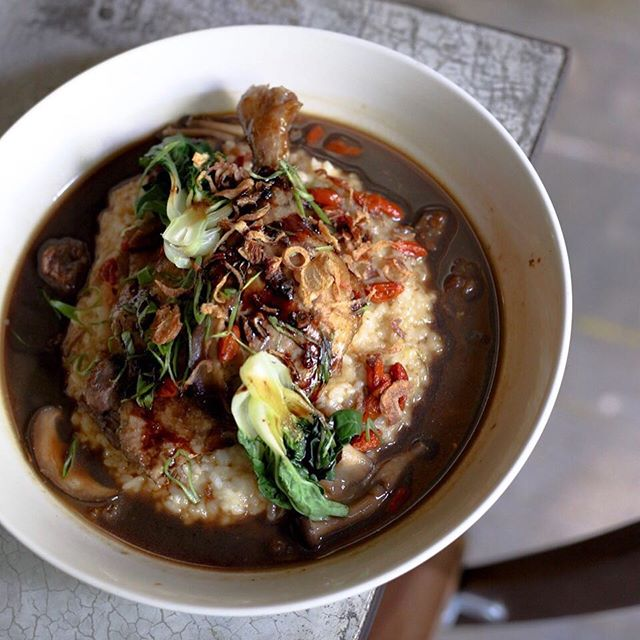 Herbal duck risotto - You get a slab of duck confit, drenched in umami herbal sauce on a bed of risotto.