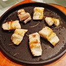 Pan Fried Live Eel on Hot Plate.