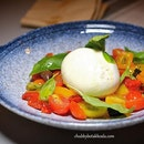 """Burrata E """"Datterini"""" (S$24) - Imported Burrata with cherry tomatoes, capers and olives."""