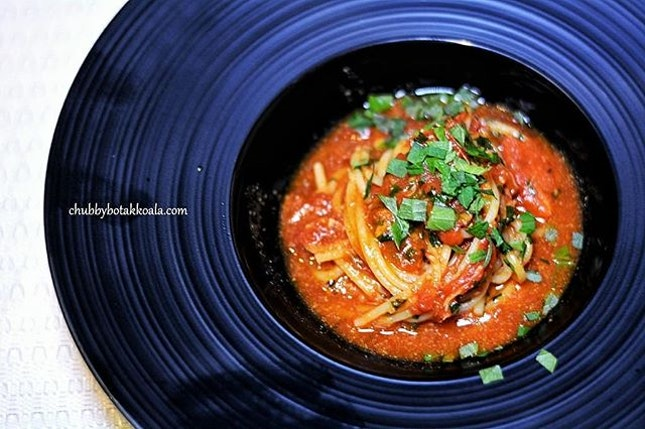 Pasta,Signature Shiso & Omaru Dashi Pasta served with Crab, Shiso (Japanese perilla), Omaru Lobster Dashi and Tomato.