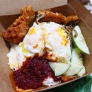 This Nasi Lemak is so good; Fluffy basmati rice with sambal chilli, crispy chicken wings and TWO on-point eggs.😋
