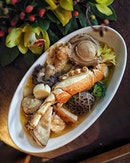 Luxurious Pen Cai which includes 4-head abalone, lobster, scallop, prawn, sea cucumber, dried oyster roll, conpoy, dace fillet, black moss, Tientsin cabbage, yam, roasted pork belly, roasted duck, chicken and wolfberries.