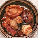 Chinese New Year Pun Choy 锦绣精装盆菜 filled with a treasure trove of ingredients such as premium abalone, dace fishballs, dried oysters, dried scallops, sea cucumbers, Chinese mushrooms, fish maw., soy sauce chicken, roasted duck, pork shank and black moss.