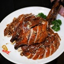 Kam's Golden Roast Duck with 22 carat French Gold Flakes ($88.00/whole) .