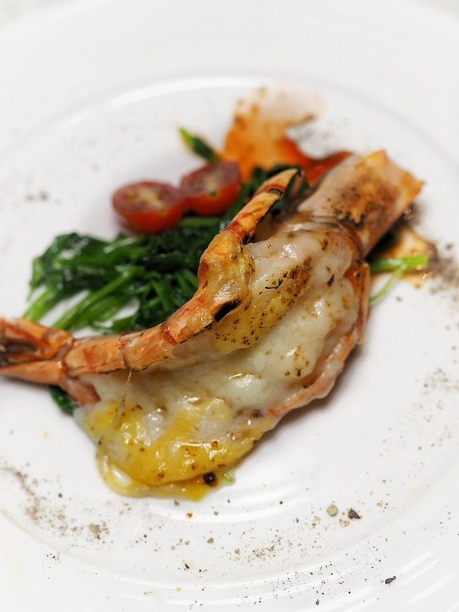 Baked King Prawn infused with Chardonnary Sauce and Seasonal Garden Green