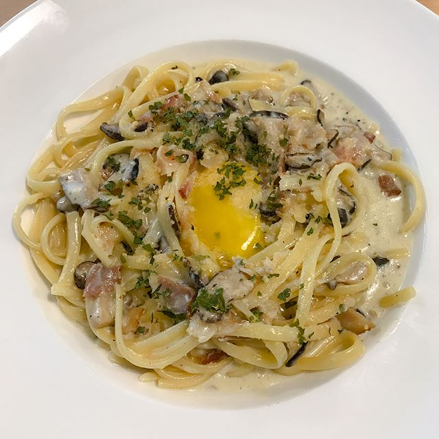 Carbonara [$16+] Linguine in a creamy carbonara sauce served with bacon, mushrooms and topped with a raw yolk.