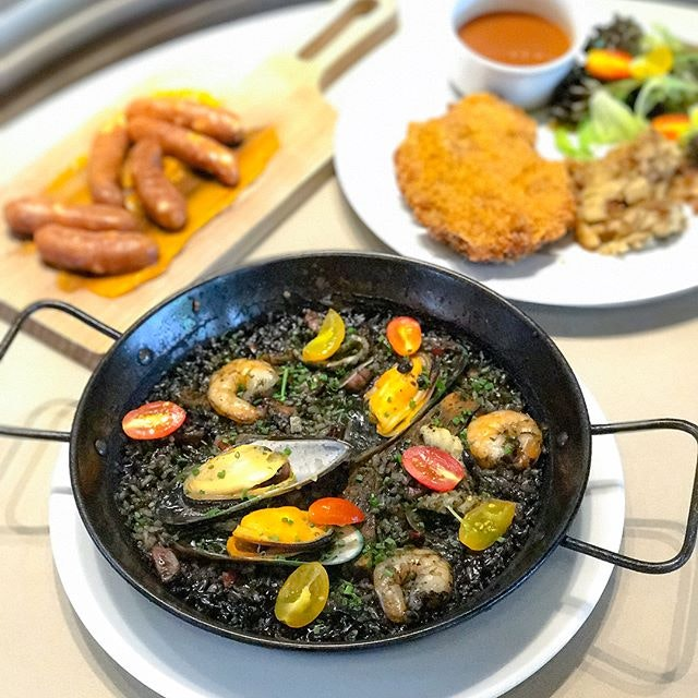Squid ink seafood paella [$32++] By far the most expensive dish on the menu but the portion was really huge and filling!