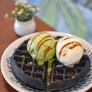 Charcoal mochi waffle [$6.70] with Standard double scoops [$6.80] .