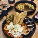 Special tteokbokki [$14.90] with mozzarella cheese [+$2] .