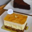 Citron Melon cheesecake [$8.90]Flourless chocolate cake [$6.50] .