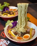 Truffle king ramen [$18.90++] with seasoned egg [+$2++] .