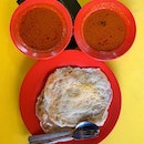 Breakfast on the 8th day of the Year of the Rat at Saffrons is the best possible option:  prata kosong and plaster prata, with the famous fish curry, and my Kopi s kosong.