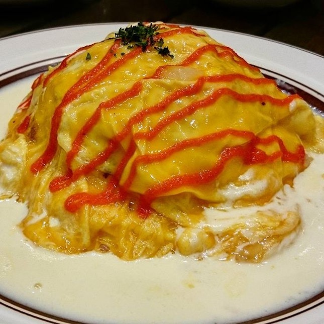 Mentaiko Omu Rice ($13.99)  Ketchup fried rice enveloped in fluffy omelet and bathed in cream sauce.