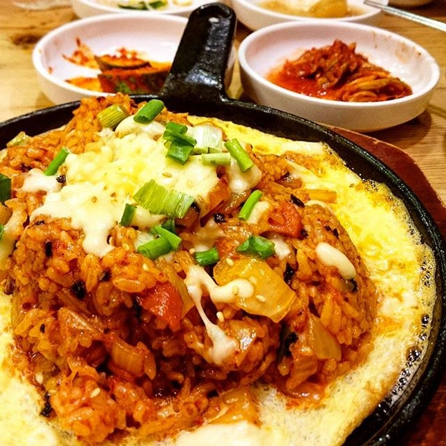 Kimchi Fried Rice With Cheese and Egg ($12.80)  Delicious fried rice topped with mozarella cheese.