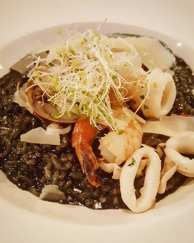 Generous portion of Squid Ink Risotto with Seafood ($28).