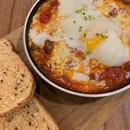Simple honest food ~ all day breakfast skillet baked eggs with toast and chic sausage!
