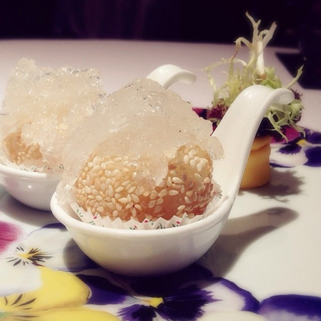 Salted egg custard within a sesame glutinous rice ball, with bird's nest piled delicately atop.