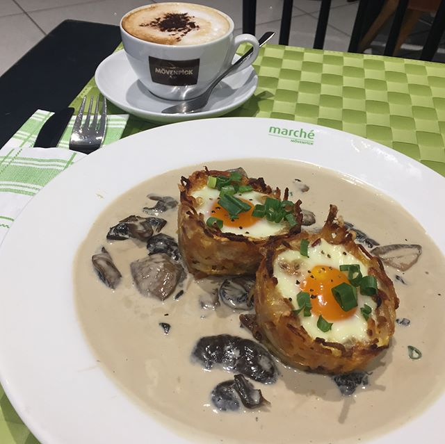 Fresh homemade nest shaped Rosti with bacon topped with sunny side-up & mushroom ragout + Cappucino = $13.90 lunch 😋 🥔 Pleasant to the eyes plating but sadly the egg was too tough & the ragout was was too sourlish.