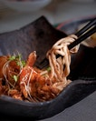 Stir-fried Fish Paste Noodle with King Prawn in XO Chilli Sauce ($36++).