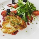 Foie gras with berry red wine sauce on toasted bread and a refreshing salad on the side.