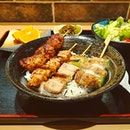 Satisfying yakitori don set with well charred skewers of chicken and leek, pork and leek, ladyfingers wrapped in bacon and meatballs.