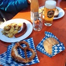 Beer, sausages, bread and PRETZELS.