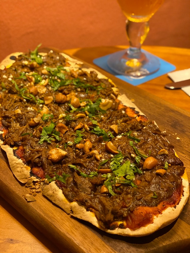 Pulled Goat Curry on Flat Bread