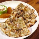 The aroma of truffle naan wafting through the air even before photography.