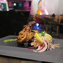 The tandoori chicken cooked on the bone, marinated in a tenderizing mixture of yogurt and spices.