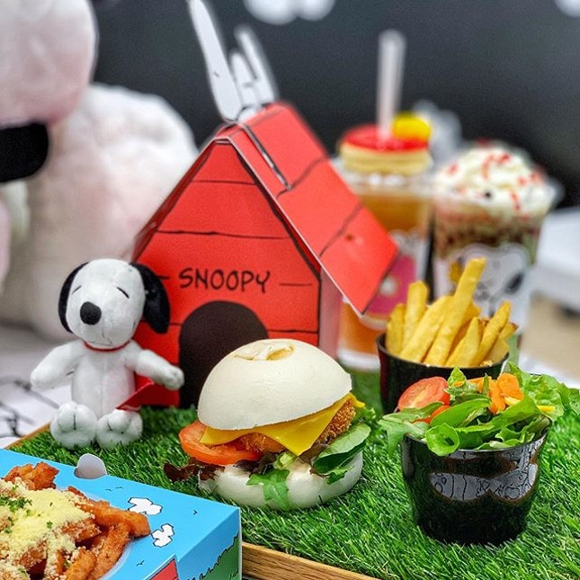Inspired by Snoopy and his iconic red dog house - the ebi burger with goma sauce, cheese alongside with golden-brown French fries and garden salad with kawaii carrot bones and cheddar Woodstock.
