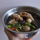 Mummy's homecook bak kut teh with lots of ingredients like pork ribs, chicken feets, meatballs, mushroom, lettuce, garlic and wolfberries.