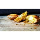 savoury Salted Egg Lava oozing out from a sweet and fluffy cheese tart that has a buttery and flakey crust...