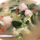 A classic oriental dish - spinach egg and meatball soup with golgi berries and bits of century egg.