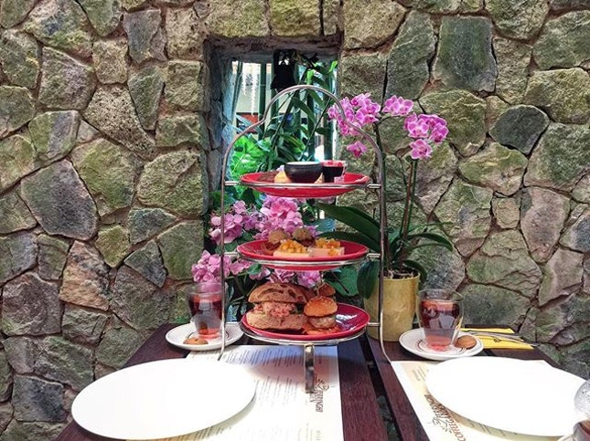High tea in a beautiful garden cafe.