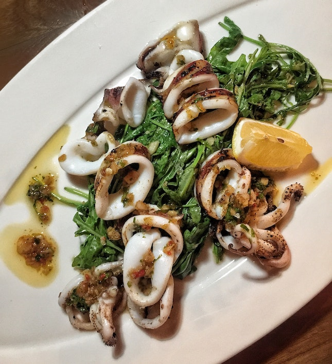 Whole Grilled Squid with Arugula Salad ($25)