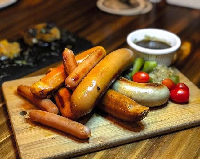 The Hideout - HOSTED TASTING - Sausage Platter (💵S$28) Chicken Mushroom Sausage, Veal Bratwurst, Pork Chorizo, Mini Pork Sausage, Sauerkraut served with Black Pepper Sauce.