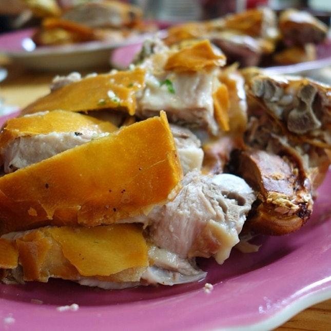3 plates full of chopped up Roast Suckling Pig.