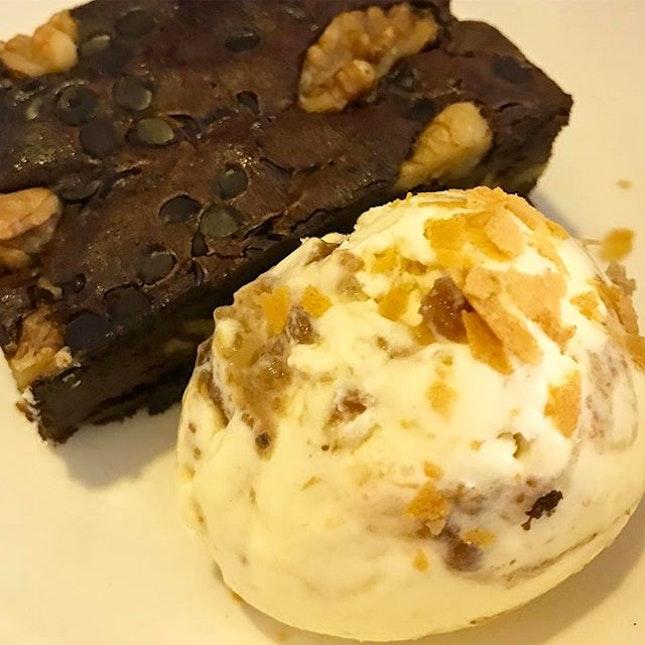 Double chocolate brownie w fig + honey ice cream .