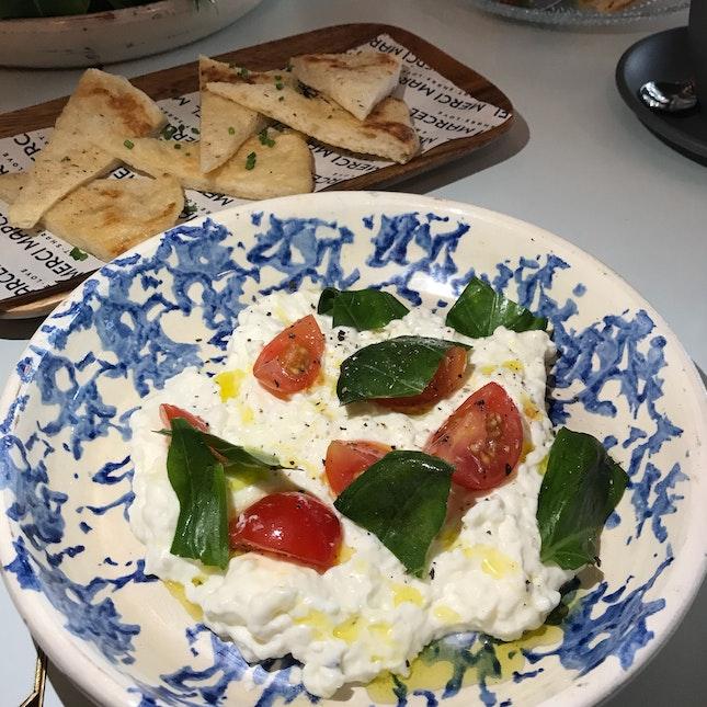 Stracciatella di bufala, extra olive oil, homemade flatbread [$16]