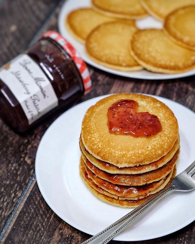 Preparing breakfast for our family with Bonne Maman strawberry jam as our spread.