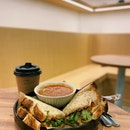 Just another relaxing quiet cafe to take a breather from work or to get a cup of coffee to get the day flowing •  Simple homemade sourdough with no additives sandwich, comes with a choice of fresh tomato soup or homemade gula melaka dressing salad •  Cajun Chicken Sandwich RM15.50 •  #sandwich #coffeecafe #flowcoffee #mutiaradamansara #menaranucleus #cafehopping #cafemalaysia #homemadesourdough #burpple #burpplekl #tummytalk