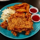 Loving this giant Crispy Chicken with potato wedges and coleslaw!