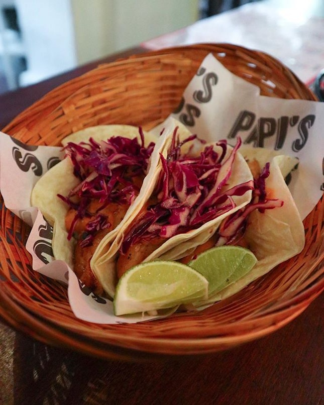 It's the Tacos de Pescado — grilled white dory, fresh cabbage, and smoked chipotle aioli on a flour tortilla.