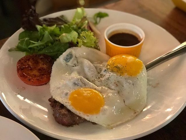 •Steak and Eggs• 🥩🍳🥗😋👍🏻 150gm grilled ribeye steak topped with two sunny-side up eggs served with homemade entrecôte sauce!