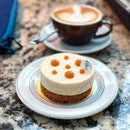 Coconut cheesecake + latte.